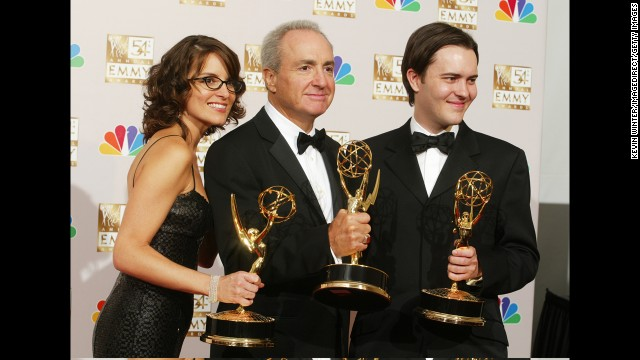 Tina Fey, Lorne Michaels, center, and Dennis McNicholas with Emmys in 2002.
