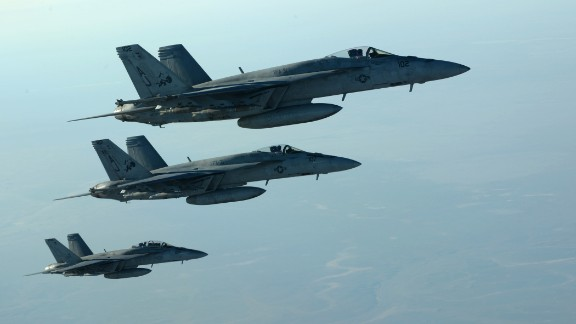 In this photo released by the U.S. Air Force, fighter jets fly over northern Iraq as part of coalition airstrikes in Syria on Tuesday, September 23. The United States and several Arab nations have started bombing ISIS targets in Syria to take out the militant group's ability to command, train and resupply its fighters.