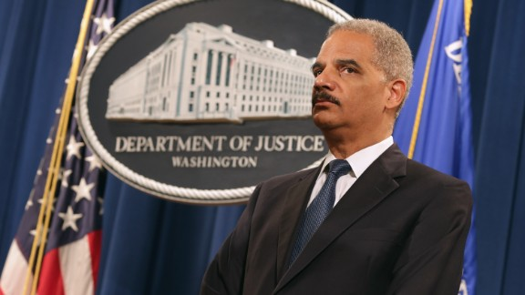 WASHINGTON, DC - MAY 13:   U.S. Attorney General Eric Holder participates in a news conference at the Justice Department May 13, 2014 in Washington, DC. Holder announced that the Justice Department has reached a $60 million settlement with Sallie Mae after it was discovered the student load giant charged roughly 60,000 military service members excessive interest rates on their education loans.  (Photo by Chip Somodevilla/Getty Images)