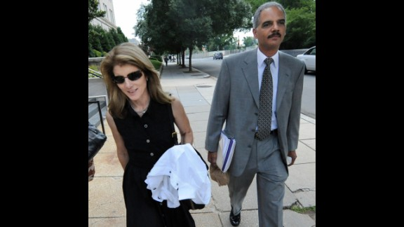 Holder walks with Caroline Kennedy, daughter of former President John F. Kennedy, in June 2008 after they were tasked with searching for a running mate for then-Sen. Barack Obama.