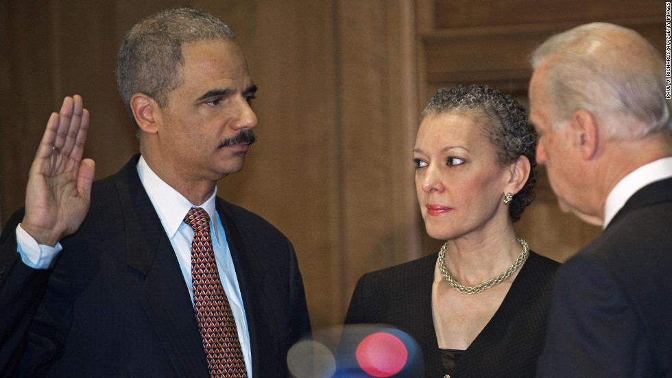 Holder is sworn in as attorney general by Vice President Joe Biden in February 2009. Holder's wife, Dr. Sharon Malone, is by his side.