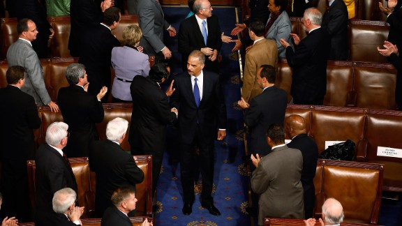 Holder is greeted by members of Congress as he arrives at the U.S. House of Representatives in May 2010.