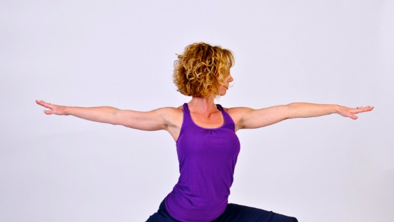 The Warrior II pose tests and trains your body's alignment.