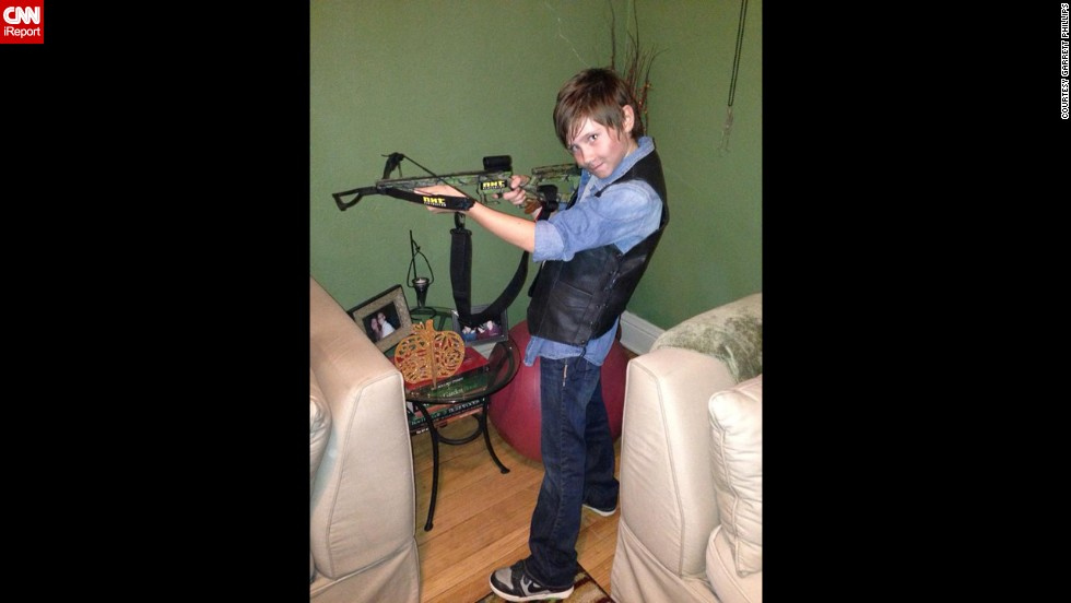 "<a href=""http://ireport.cnn.com/docs/DOC-1165141"">Garrett Phillips</a>' 10-year-old daughter, Evie, dressed up as Daryl Dixon, her favorite character from ""The Walking Dead,"" last Halloween. ""She's all girl with ears pierced and painted fingernails but wants to wear boys' clothes and play sports with boys,"" her father said."