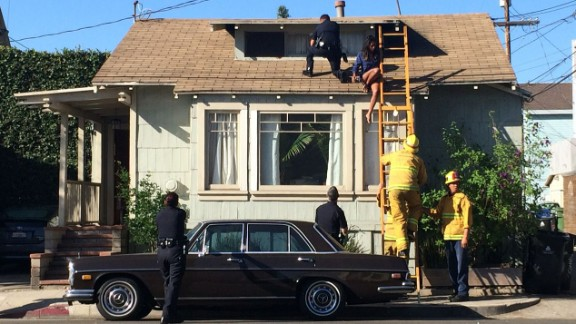 A ladder was used to help Rivera off the roof. She was in bed and home alone when the incident took place, according to police and KCAL.