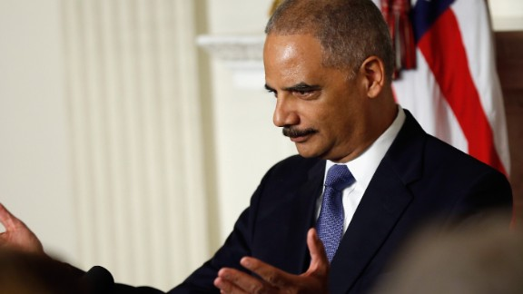 Attorney General Eric Holder says the Justice Department is sending election monitors to 18 states for Tuesday's midterms.