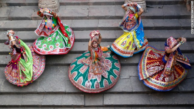 "Women dressed in traditional attire pose as they take part in rehearsals for the ""garba"" dance ahead of the Navratri festival at Adalaj Stepwell, a five level octagonal step-well complex built in the 15th century, in the western Indian city of Ahmedabad September 21, 2014. Navratri, held in honour of Hindu Goddess Durga, is celebrated over a period of nine days where thousands of youths dance the night away in traditional costumes. Navratri starts on September 25."