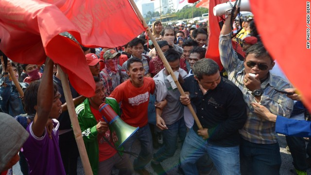 Indonesian students and activists protest against a new bill on local elections in Jakarta.