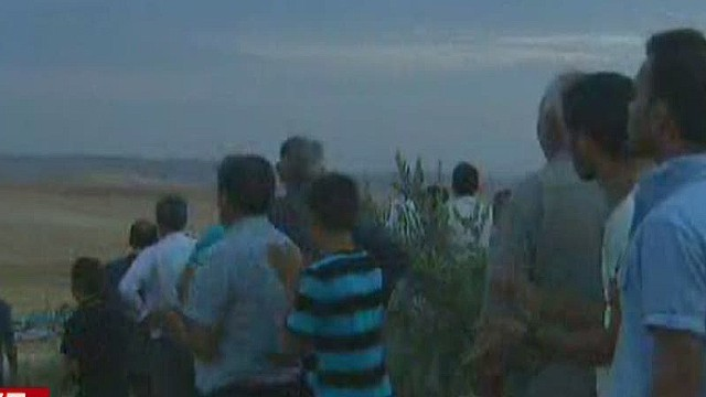 ath black live ISIS fighting Turkey border refugees_00003027.jpg
