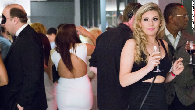 Young women attend a party hosted by SeekingArrangement.com, a website that matches young women with rich, older men.