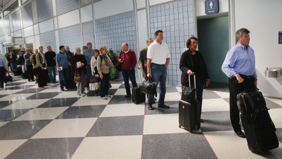 SEPTEMBER 24: Passengers wait in line to go through security screening at O'Hare International Airport's Terminal 1 shortly after the terminal was reopened on September 24, 2014 in Chicago, Illinois. The ticketing and baggage claim areas of the terminal were evacuated for nearly two hours after a after an unattended bag was discovered around 9:30 this morning. (Photo by Scott Olson/Getty Images)