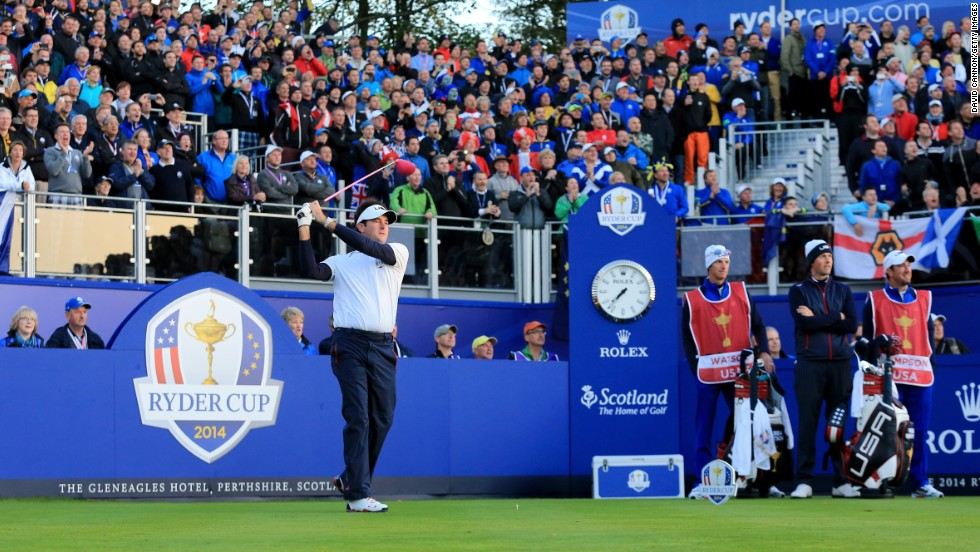 Webb Simpson and Bubba Watson (left) got Team USA's challenge underway on Friday morning in front of crowds massed around the first tee at Gleneagles.