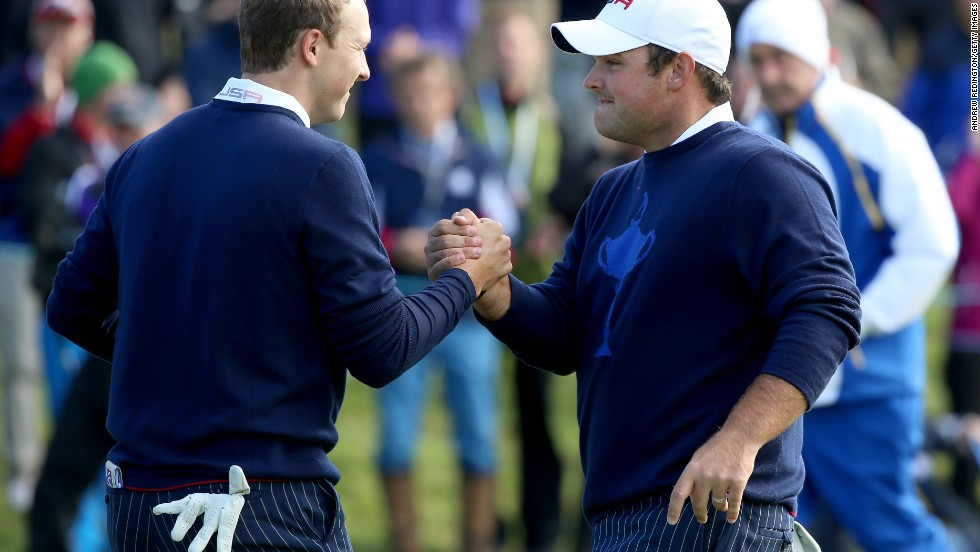 Poulter and partner Stephen Gallacher were unable to contain the U.S. pairing of Jordan Spieth (left) and Patrick Reed who ran out comfortable 5&4 winners, giving Team USA their first point.