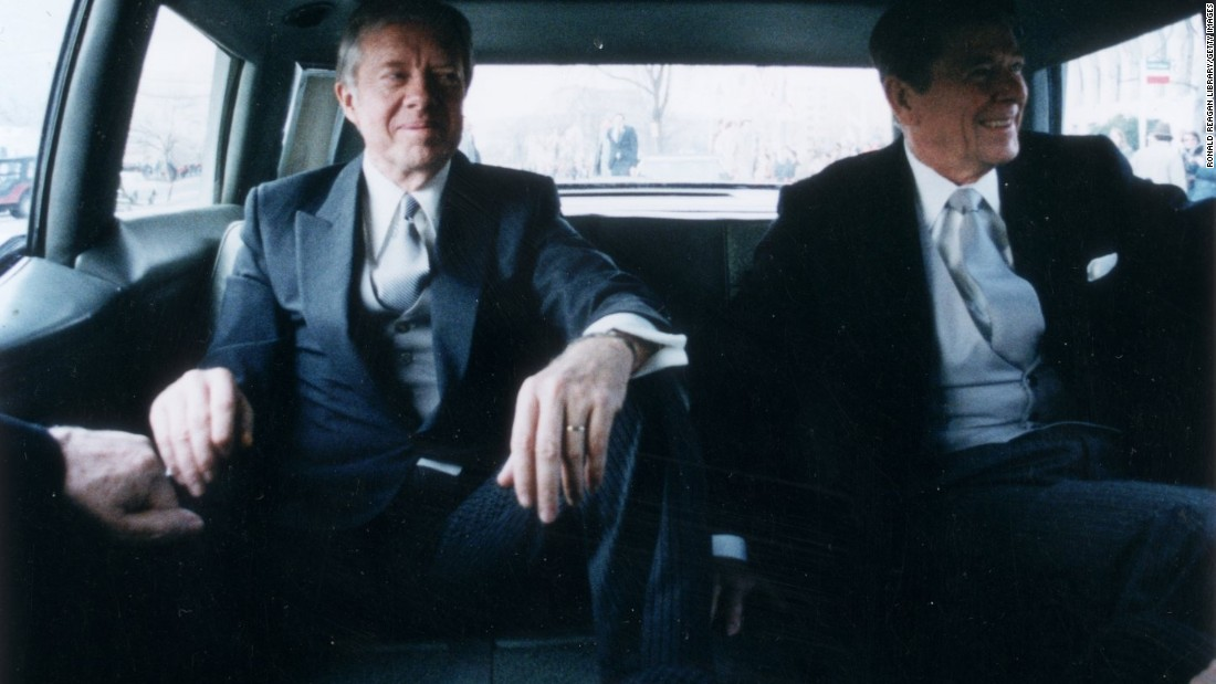 Outgoing President Jimmy Carter, left, sits with president-elect Reagan in the back of a limousine en route to Reagan's inauguration on January 20, 1981.