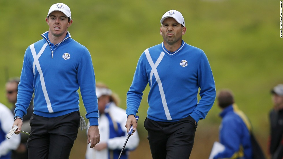 Rory McIlroy (left) and Sergio Garcia banished the disappointment of losing in the morning fourballs with a gutsy performance in the afternoon foursomes. The pair won the final two holes to claim a half against Ricky Fowler and Jimmy Walker.