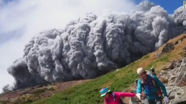 Volcanic ash envelops hikers
