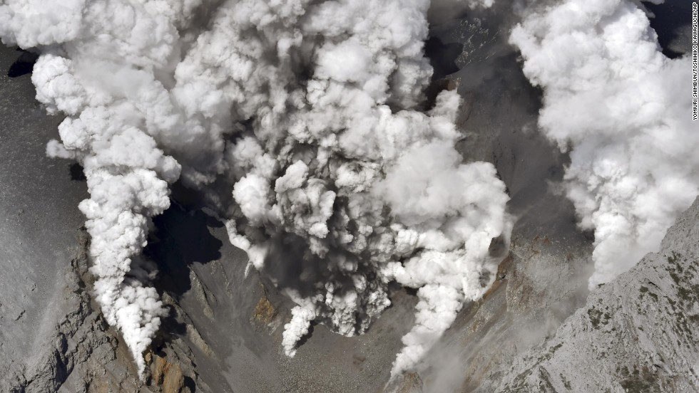 Dense fumes are spewed out from several spots on the slope of Mount Ontake.