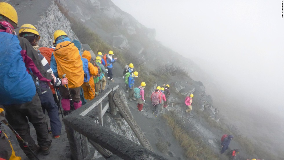 Climbers flee the mountain as the eruption coats the area in a layer of ash.