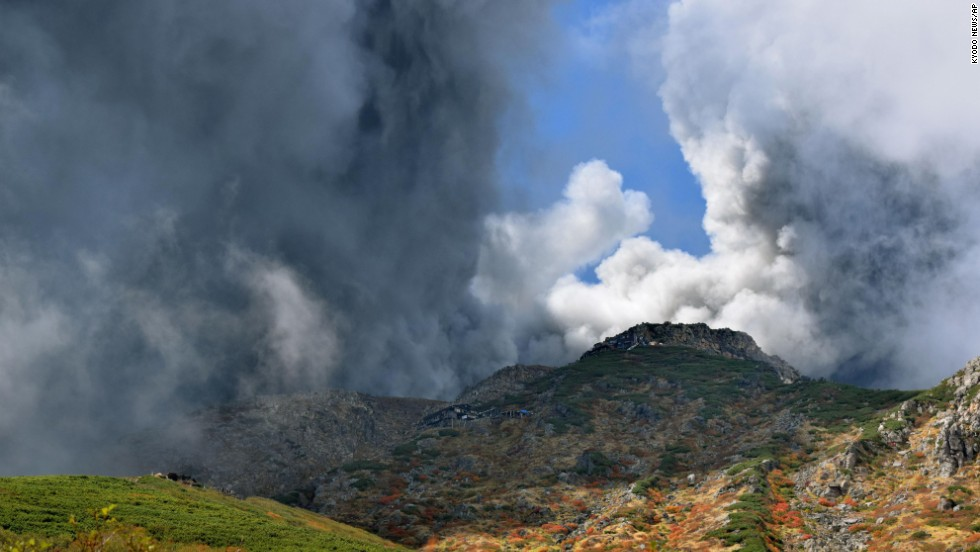Smoke and ash rise from the summit crater of Mount Ontake.