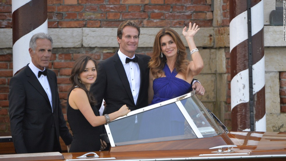 Model Cindy Crawford, right, boards a taxi boat with her husband, Rande Gerber, and other guests.