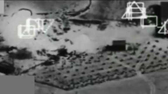 An image from a video released by the Department of Defense showing an airstrike on an ISIS compound near Kobani, Syria on Saturday, September 27.