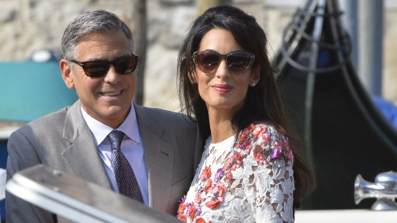 Actor George Clooney and his wife, attorney Amal Alamuddin, stand on a taxi boat on the Grand Canal in Venice, Italy, on Sunday, September 28. Clooney and Alamuddin married in Venice the previous day at a private ceremony attended by celebrities.