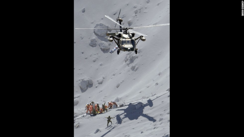 Rescuers assist an injured person on September 28.