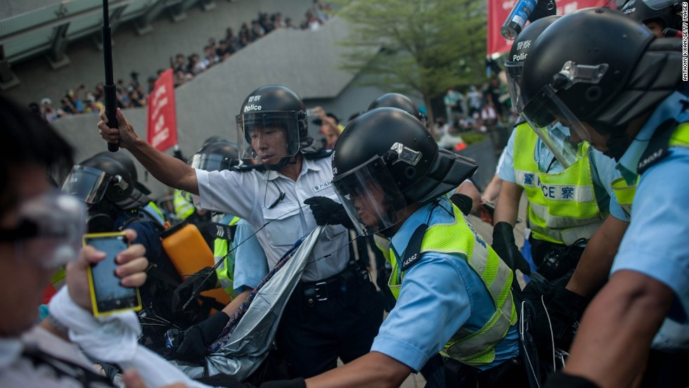 Riot police clash with protesters on September 28.