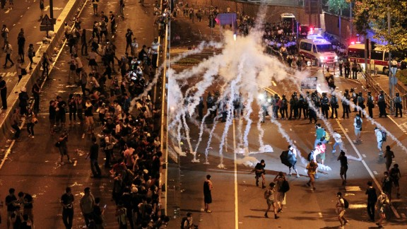 Riot police fire tear gas on student protesters occupying streets around government buildings in Hong Kong on September 29.