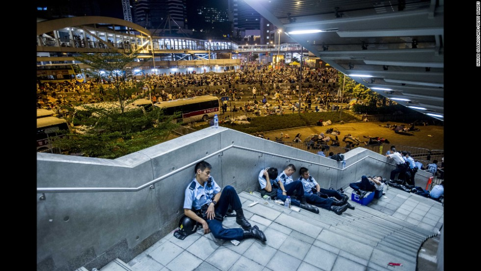 Police officers rest after protests on September 29.