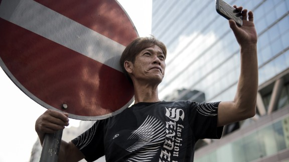 If the image of the barricade defined protest and dissent in the 20th century, the mobile phone is defining it in the 21st century. The ability of protesters to organize and mobilize quickly through mass communication has been critical for civil disobedience movements like 'Occupy Central' in Hong Kong.