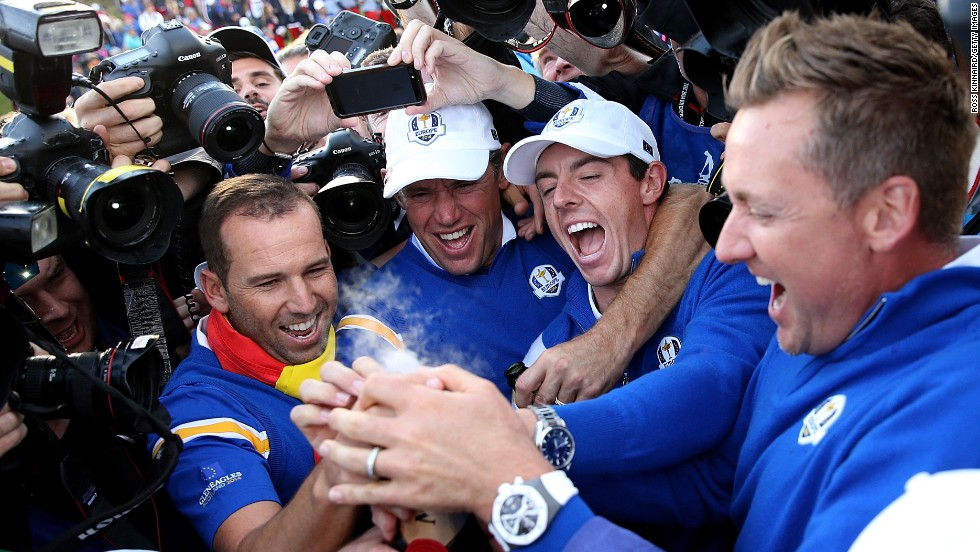 "From left, golfers Sergio Garcia, Lee Westwood, Rory McIlroy and Ian Poulter pop champagne Sunday, September 28, to celebrate <a href=""http://www.cnn.com/2014/09/28/sport/golf/ryder-cup-gleneagles-europe-wins/index.html"">Europe's third straight victory</a> in the Ryder Cup. Europe has defeated the United States in eight of the last 10 Ryder Cup competitions, which are held every two years."
