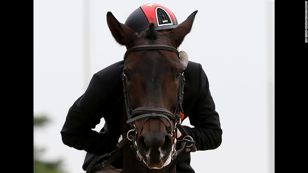 Liang Ruiji rides Vasthi during an equestrian event Friday, September 26, at the Asian Games in Incheon, South Korea.