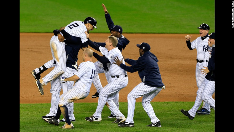 "Derek Jeter (No. 2) celebrates with his New York Yankees teammates after hitting a game-winning RBI in his final game at Yankee Stadium on Thursday, September 25. Jeter had already announced that this would be his final season of <a href=""http://www.cnn.com/2014/09/22/worldsport/gallery/derek-jeter/index.html"">his 20-year career.</a> ""I don't think there's a more fitting way for it to end,"" Yankees manager Joe Girardi said."