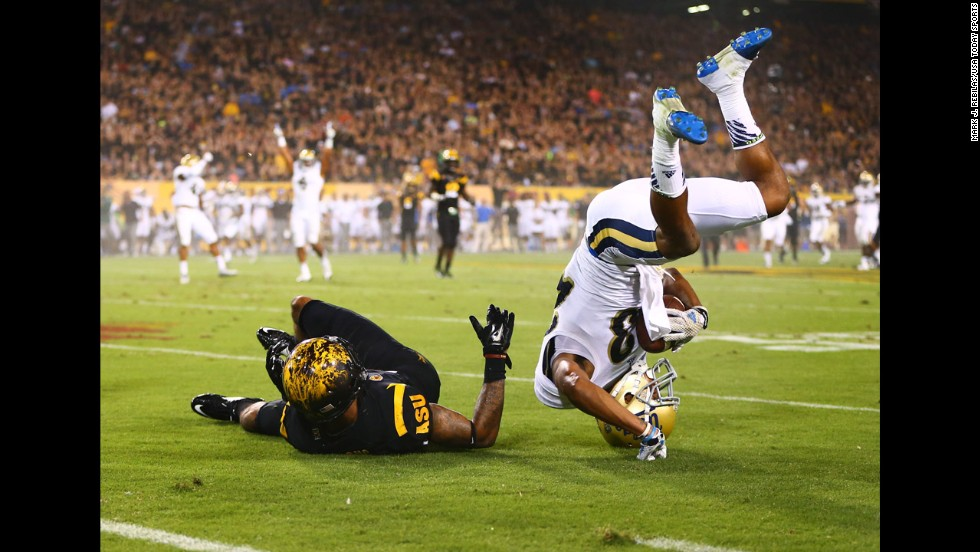 UCLA defensive back Anthony Jefferson, right, lands after intercepting a pass against Arizona State on Thursday, September 25, in Tempe, Arizona. UCLA blew out the Sun Devils 62-27 in an early season Pac-12 showdown.