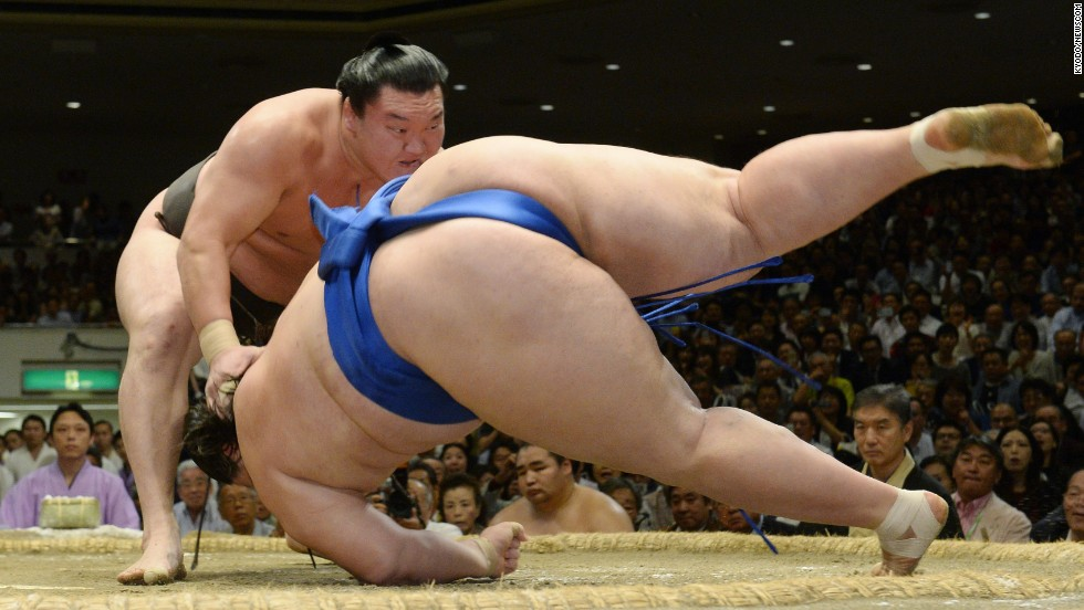 "Sumo wrestler Hakuho, left, defeats Ichinojo on Saturday, September 27, at the Autumn Grand Sumo Tournament in Tokyo. The next day, Hakuho would clinch the tournament title — the 31st title of his career. He is now one short of the all-time record held by Taiho, according to <a href=""http://www.japantimes.co.jp/sports/2014/09/28/sumo/basho-reports/dominating-hakuho-wins-31st-career-title/"" target=""_blank"">The Japan Times.</a>"