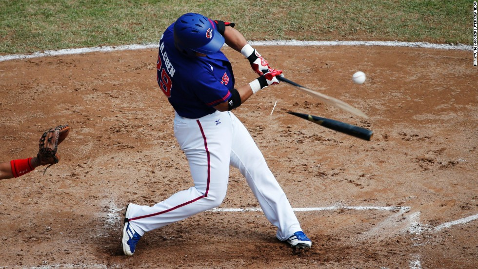 Chun-Hsiu Chen, playing for the Chinese Taipei team, breaks his bat during the semifinal game against Japan on Saturday, September 27, at the Asian Games in Incheon, South Korea. His team won the semifinal but lost in the final to South Korea.