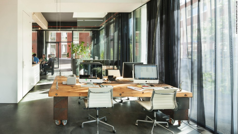 Disappearing Desks Promote Better Work Habits CNN - Large office work table