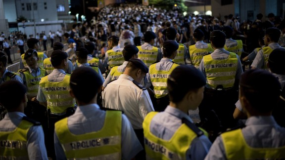 Police officers stand off with protesters next to the Hong Kong police headquarters on September 29.
