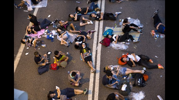 Protesters sleep on the streets outside the Hong Kong Government Complex at sunrise on September 30.