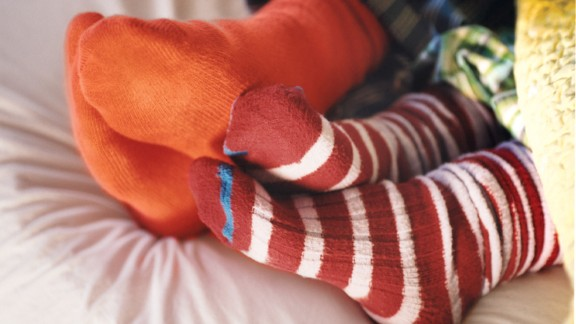 Place socks in the washer tub first, so they're less likely to attach themselves to other garments.
