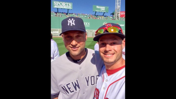 Boston Red Sox pitcher Joe Kelly, right, snaps a selfie with retiring New York Yankees captain Derek Jeter before Jeter played the final game of his career Sunday, September 28, in Boston. Kelly tweeted the photo with the hashtags #RE2PECT and #2ELFIE in honor of Jeter