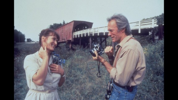 """The Bridges of Madison County"": Robert James Waller's 1992 novel about the romance between a lonely Iowa farm wife and a National Geographic photographer lingered on bestseller lists for three years and sold 50 million copies. Clint Eastwood stars in (and directs) the 1995 movie version with Meryl Streep."