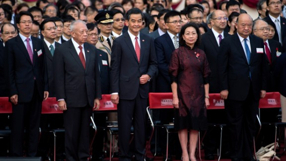 C.Y. Leung, center, attends a ceremony to mark the 65th anniversary of the founding of the People's Republic of Communist China on October 1.