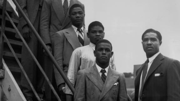 22nd June 1948: From the top, hopeful Jamaican boxers Charles Smith, Ten Ansel, Essi Reid, John Hazel, Boy Solas and manager Mortimer Martin arrive at Tilbury on the Empire Windrush in the hope of finding work in Britain.
