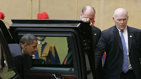 Clancy, right, holds the door for Obama during a trip to the Vatican in July 2009.