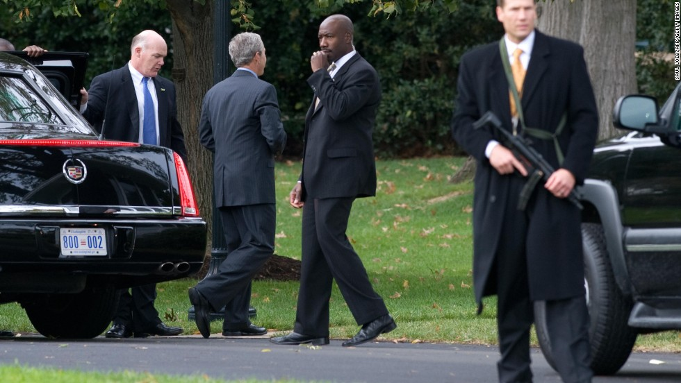 Clancy holds the door for President George W. Bush in October 2008.