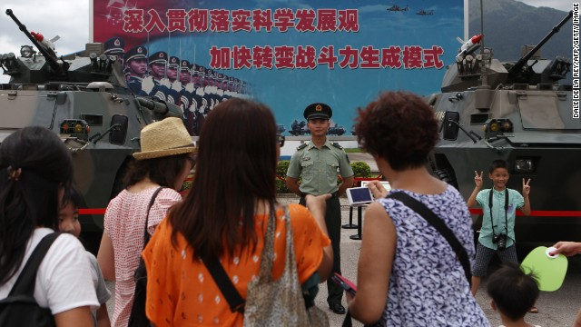 Visitors take photographs with PLA personnel during an open day at their barracks in Hong Kong in June.