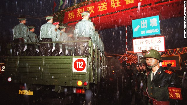 Convoys of PLA trucks and armoured vehicles cross into Hong Kong on July 1, 1997.