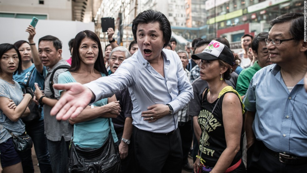 A man shouts at a pro-democracy demonstrator on October 3.